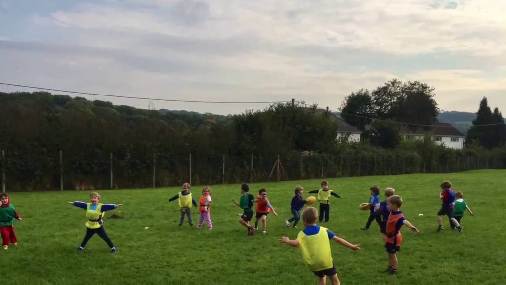 Children in rugby exercises