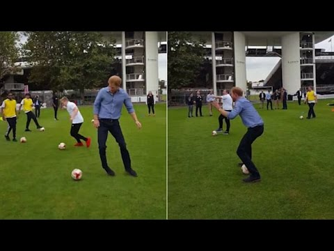 Prince Harry shows off his football skills at Lord's celebrations