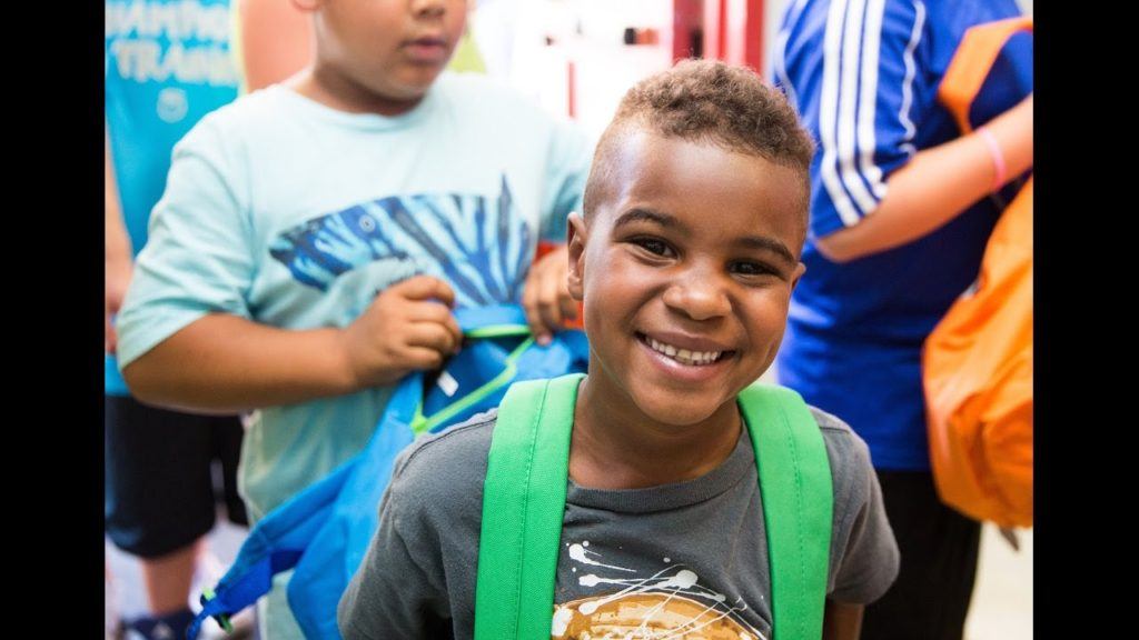 Seahawk Kam Chancellor Gives Backpacks   Seattle's Union Gospel Mission