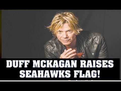 Duff Mckagan Raises Seattle Seahawks Flag At NFL Game