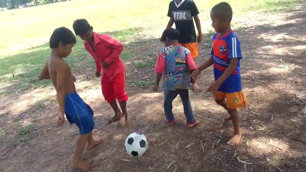 The boy play football in Cambodia  2 VS 3