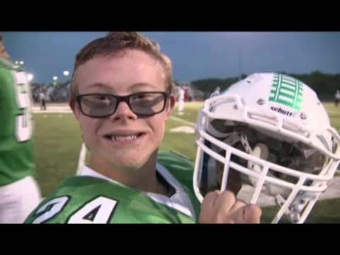 High school football team lets water boy with special needs score touchdown to surprise terminally i