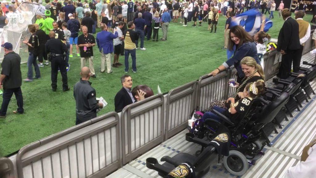 Seattle Seahawks John Schneider gives football to an amazing little girl!