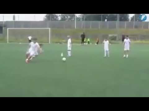 Amazing small boy playing football