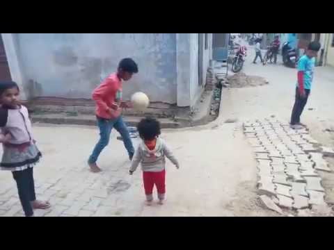 Kid playing football – See how innovatively she is playing with others :)