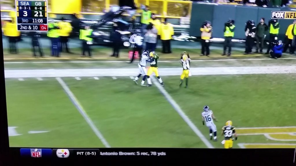 Quinten Rollins #24 catches ball from Jermaine Kearse #15 Seahawks