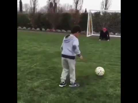 Cristiano Ronaldo playing football with his son.