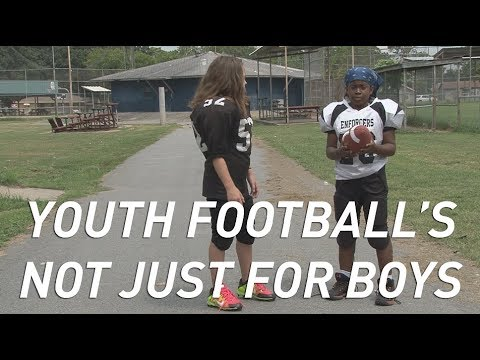 Two girls proving stereotypes wrong by playing football
