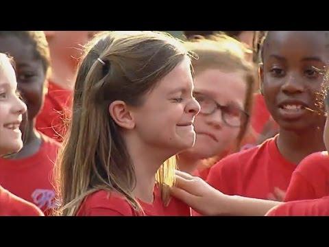 Marine surprises daughter at baseball game