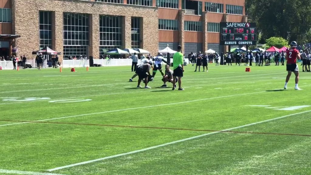 Seattle Seahawks' Jacob Hollister catches passes during training camp
