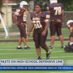 Girl plays defense on football team