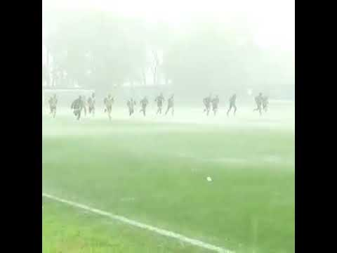 Inter football team exercises in heavy rain