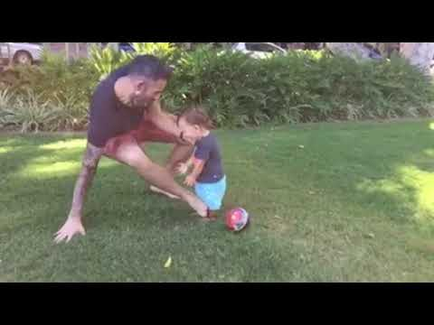 kid gets tackled when playing football in slow motion