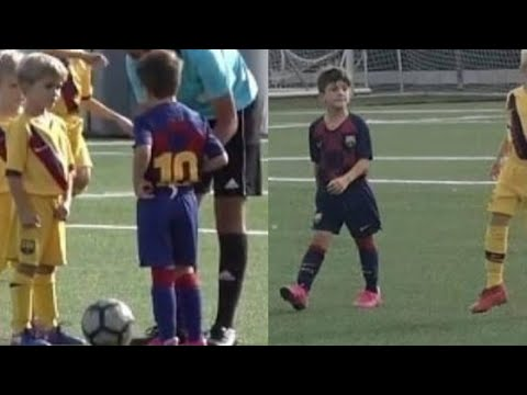 Thiago Messi playing football in a game of FCB escola