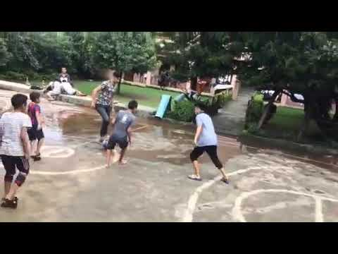 Guy Playing Football With Kids Slips Over Water and Falls – 1064715