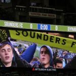 Scarves up, Seattle!!  Macklemore leads the Sounders fans in saluting their team